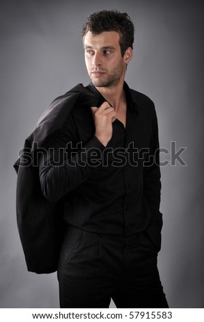 a man dressed in black business suit - stock photo
