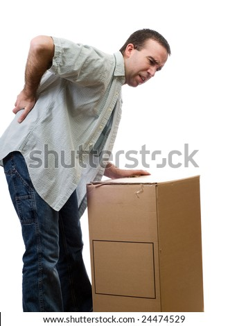 A man dressed in casual clothing, hurt his back lifting a large box, isolated against a white background - stock photo