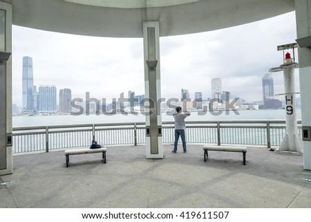 A man exercise beside HongKong city view - stock photo