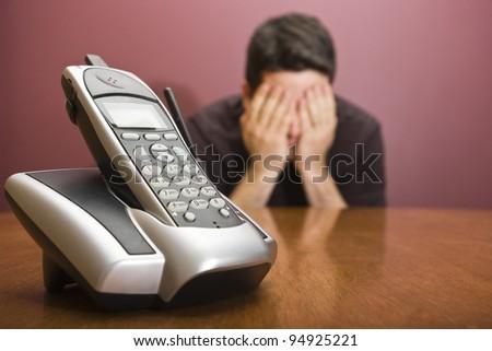 A man fears a phone call - stock photo