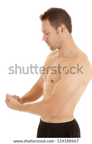 A man flexing his muscles without a shirt on with a serious expression on his face, - stock photo