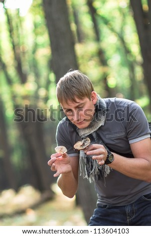a man found a mushroom in the forest - stock photo