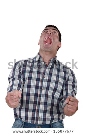 A man full of anger. - stock photo