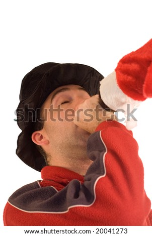 A man getting drunk while wearing Christmas clothes, isolated against a white background - stock photo