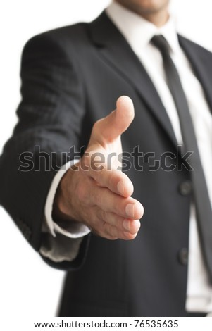 a man gives a hand toward to the camera - stock photo