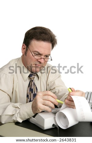 A man going over his accounts using a highlighter to identify issues.  Isolated on white. - stock photo