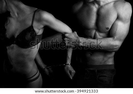 A man grabs a woman from behind - stock photo