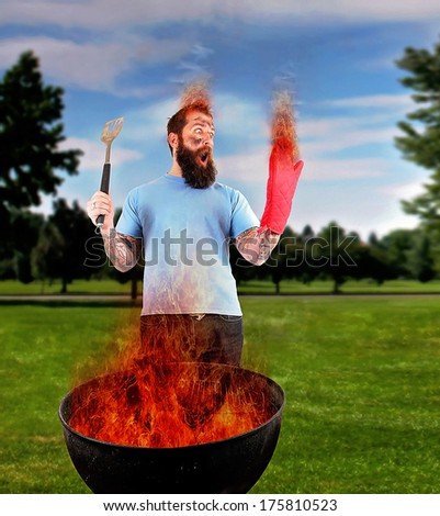 a man grilling with a fire that's too big - stock photo