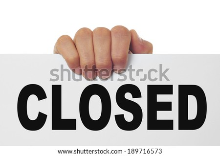 a man hand holding a signboard with the word closed written in it - stock photo
