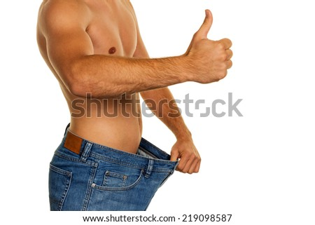 a man has fallen with a successful diet much body weight. - stock photo