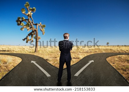 a man has to decide between two different ways - stock photo