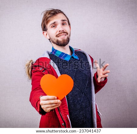 A man holding a heart - stock photo