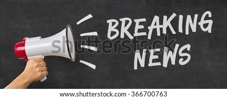 A man holding a megaphone - Breaking news - stock photo