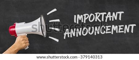 A man holding a megaphone - Important announcement - stock photo