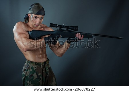 A man holding a rifle. Rifle with a telescopic sight. He was a sniper. - stock photo