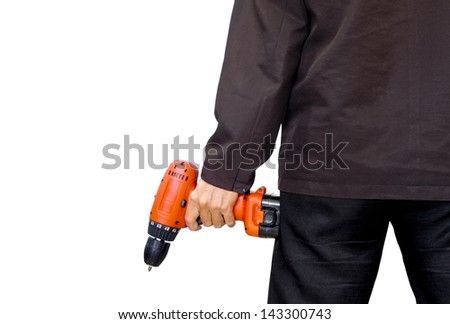 A man holding an electric drill - stock photo
