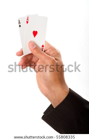 A man holding up a pair of aces - stock photo