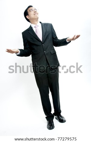 A man holding up his hands showing he has no money, isolated against a white background - stock photo