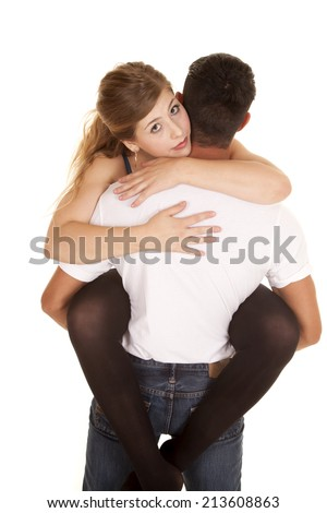 a man holding up his woman in his arms with the woman looking over his shoulder. - stock photo