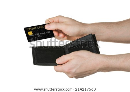 A man holds a fake credit card and a black wallet in his hand. - stock photo
