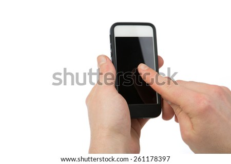 A man holds a smartphone in his hand and is using a single finger gesture on a blank screen. - stock photo