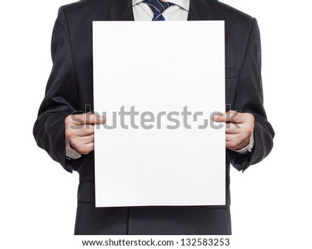 A man in a black suit holding a blank paper in the hands isolated on white background vertical - stock photo