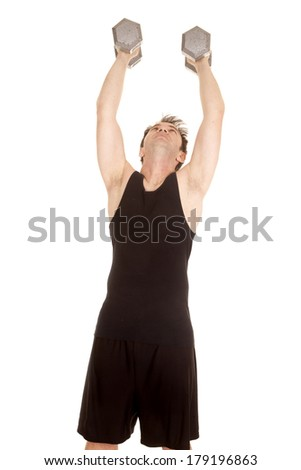 A man in a black tank top working out with weights. - stock photo