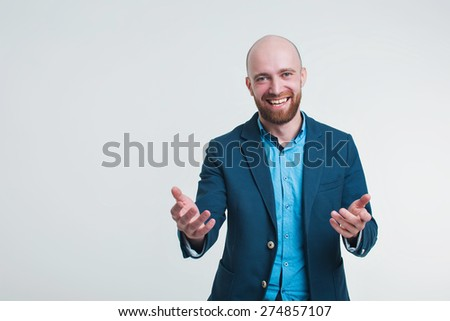 a man in a business suit running and gesturing on white background - stock photo