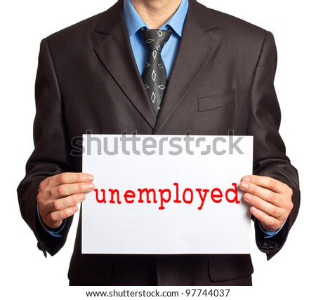"""A man in a suit holding a sign that says """"unemployed"""" - stock photo"""