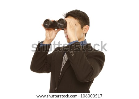 A man in business attire using binoculars (on white) - stock photo