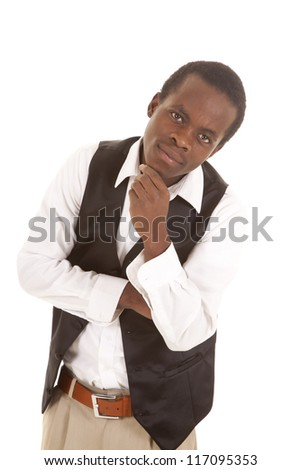 A man in his black vest and white shirt looking at the camera. - stock photo