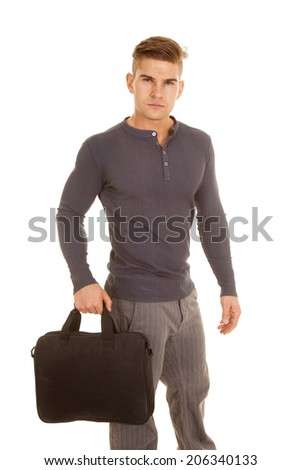 A man in his business clothing holding on to his bag heading to the office. - stock photo