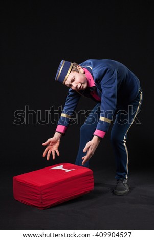 A man in uniform concierge is dropped  box - stock photo