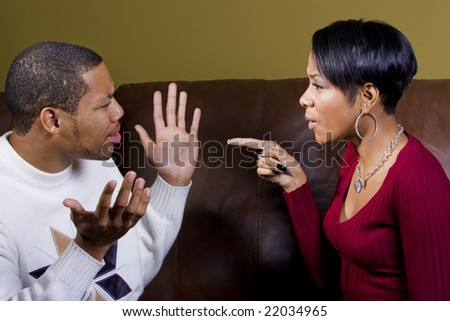 A man is accused by his lover and he denies any wrongdoing - stock photo