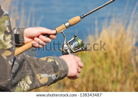 A man is fishing - stock photo