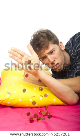 a man is getting awake, with some coins falling - stock photo