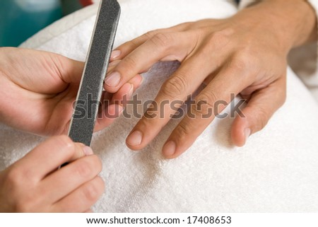 a man is getting manicure - stock photo