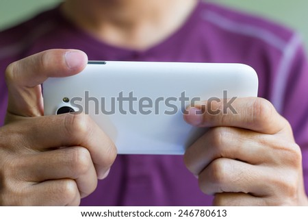 A man is using smart phone - stock photo