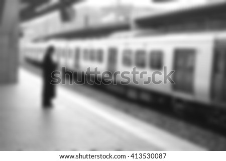 A man is waiting for train- blur for background- black and white effect   - stock photo