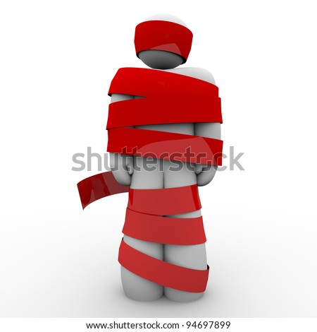 A man is wrapped in red tape representing being immobilized due to bureaucracy, kidnapping, fear or other concept keeping him from moving or acting - stock photo