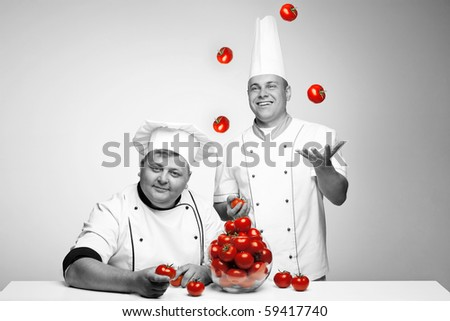 A man jugglering tomato - stock photo