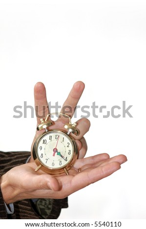 A man keeping an alarm clock in his palm - stock photo