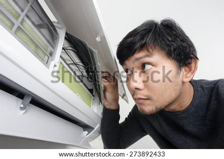 a man look inside the air condition - stock photo