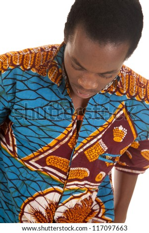 A man looking down in his colorful shirt with a serious expression on his face. - stock photo