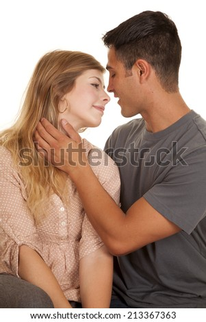 A man making a move on his woman, going in for a kiss. - stock photo