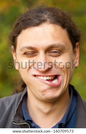 A man making grimace face, Troll face. - stock photo