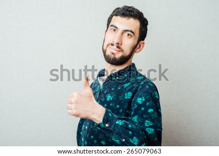 a man of Caucasian appearance showing thumbs up - stock photo