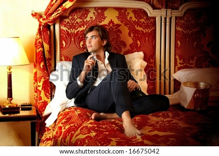 a man on the luxury bed - stock photo