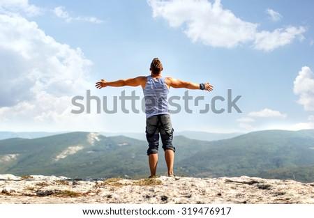a man on the mountain - stock photo