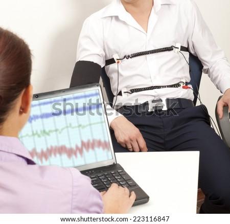 A man passes a lie detector test - stock photo